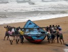 Fishermen move a fishing boat to a safer place along the shore ahead of cyclone Hudhud at Ganjam district in Odisha on October 11 2014. Reuters Stringer